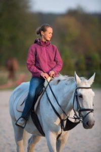 picture of a young girl riding a gray horse, gray horse coat colors, colors,