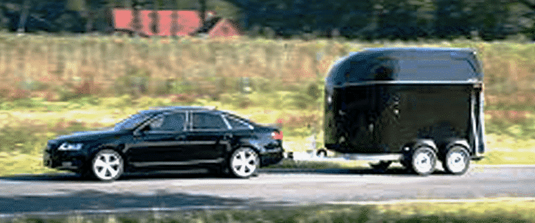Picture of a car towing a horse bumper-pull horse trailer.