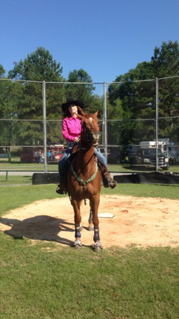 Picture of a retired racehorse being used for recreational riding.