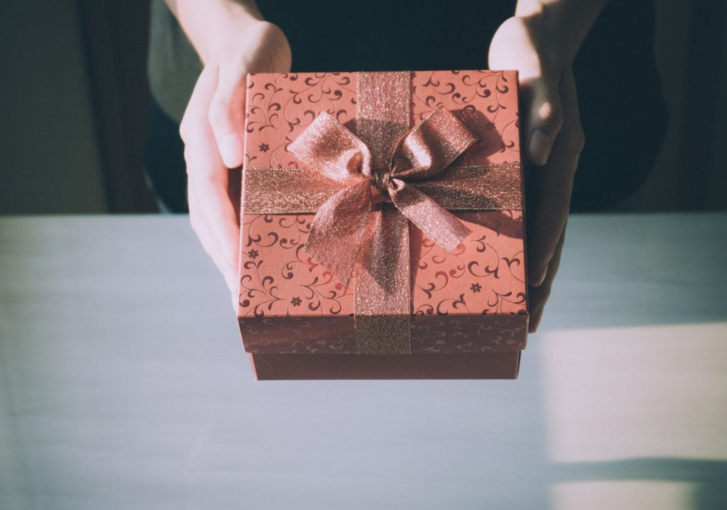 Picture of hands holding a gift box.
