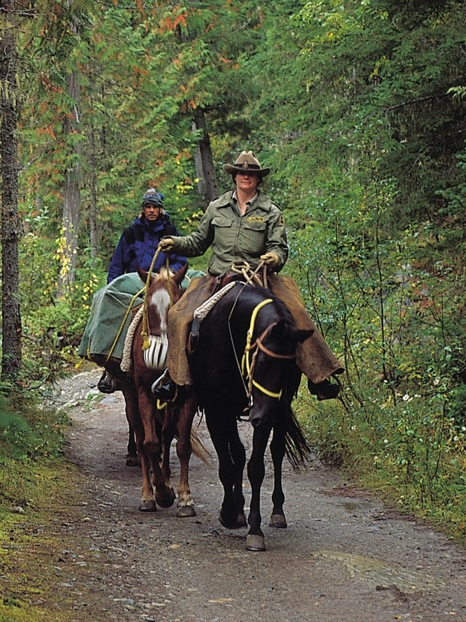 picture of men riding horses on a 20 mile trail ride,
