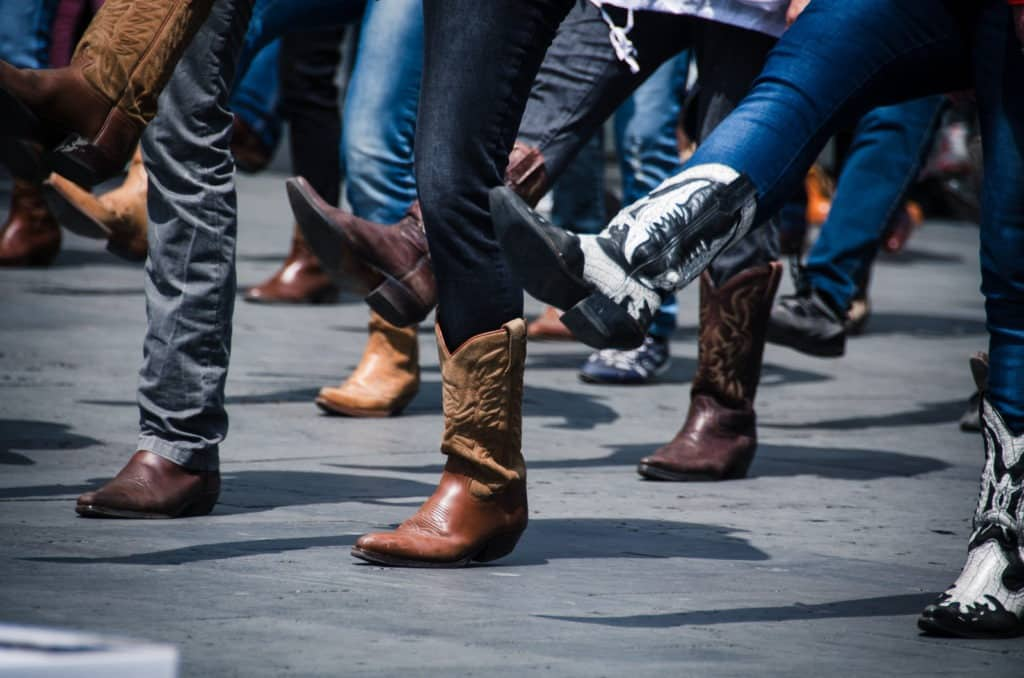 picture of people dancing in cowboy boots,
