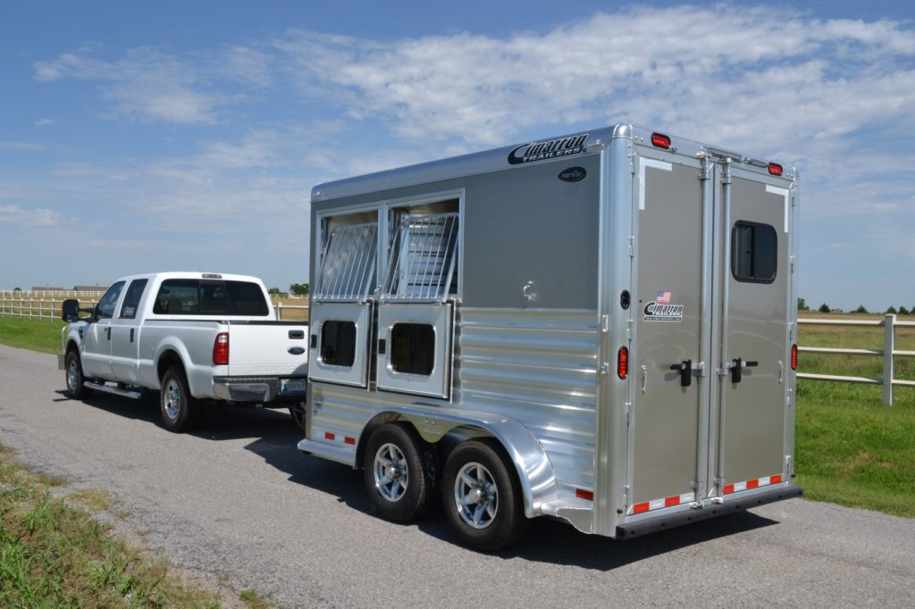 Picture of a truck towing a bumper pull, two-horse trailer,