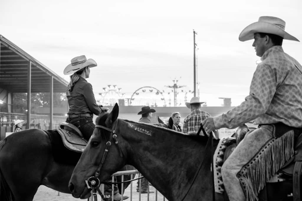 picture of a young cowgirl and cowboy sitting on horseback, cowboy, boots, made, USA,