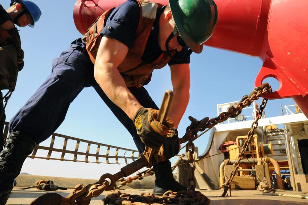 picture of man working wearing work boots, square toe, cowboy boots