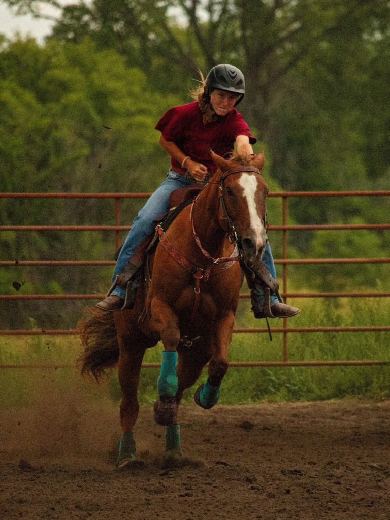 Picture of a horse running with a rider.