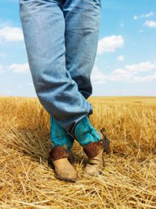 picture of man wearing cowboy boots, slip, heel, comfortable, cowboy boots