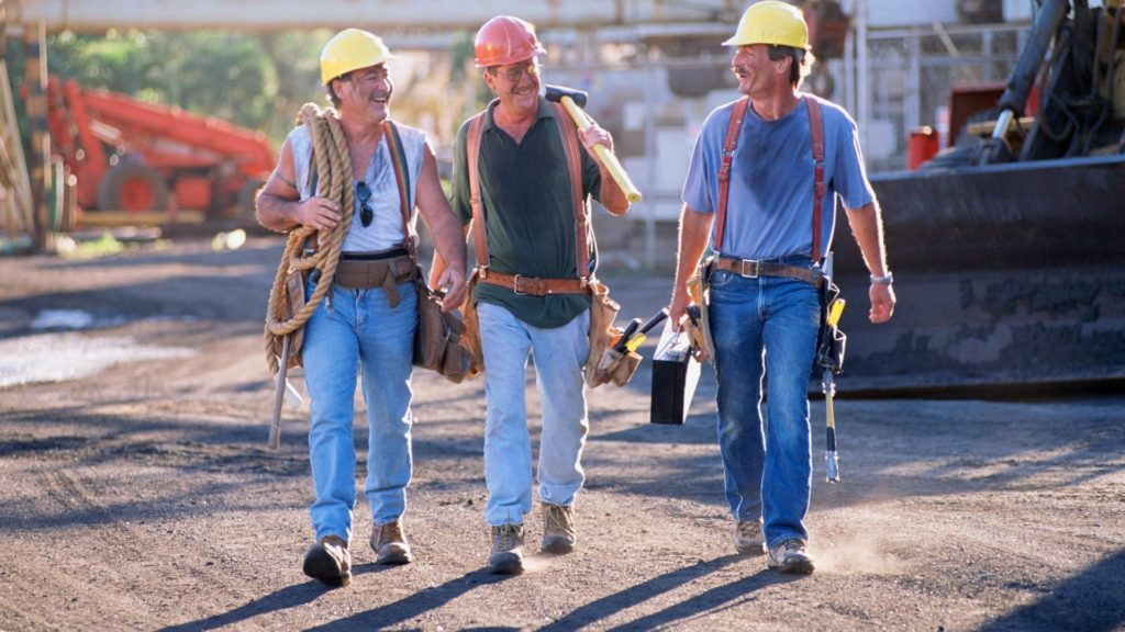 picture of construction workers walking away from a job, steel toe, work boots,  Ariat,
