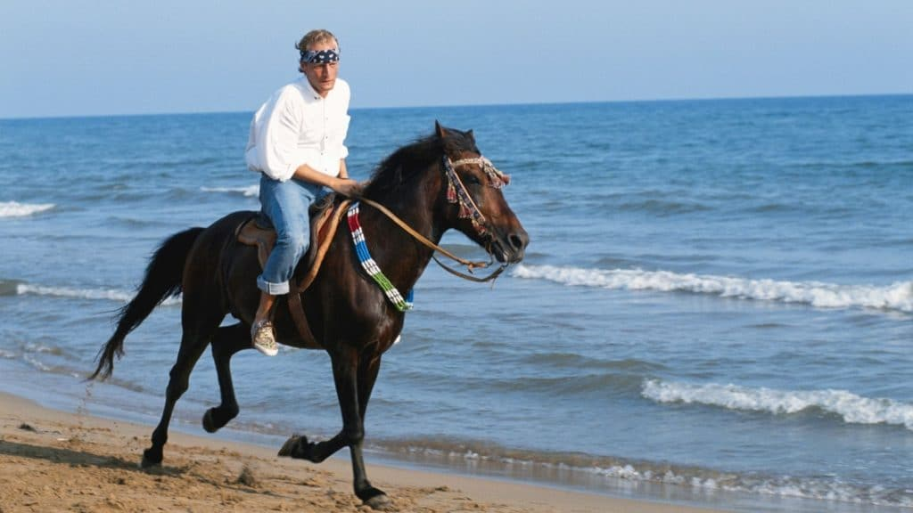picture of a man galloping a horse on the beach, beaches, horses,