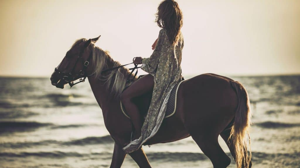 picture of a lady riding a horse on the beach, beaches, horses,