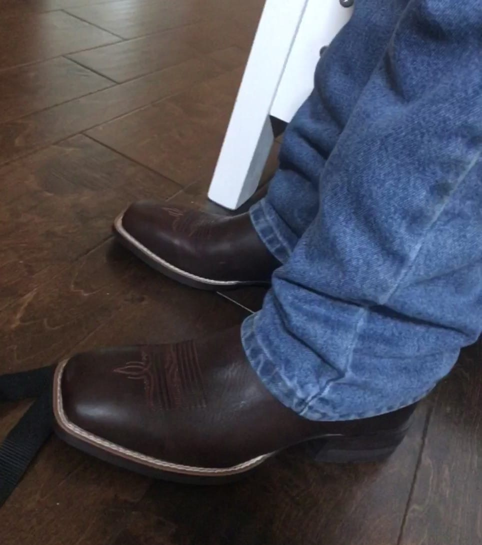 picture of me wearing my Ariat Amos cowboy boots.