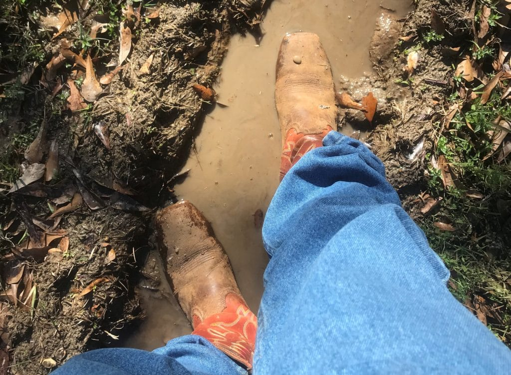 Picture of me standing in water puddle with my cowboy boots, waterproof,