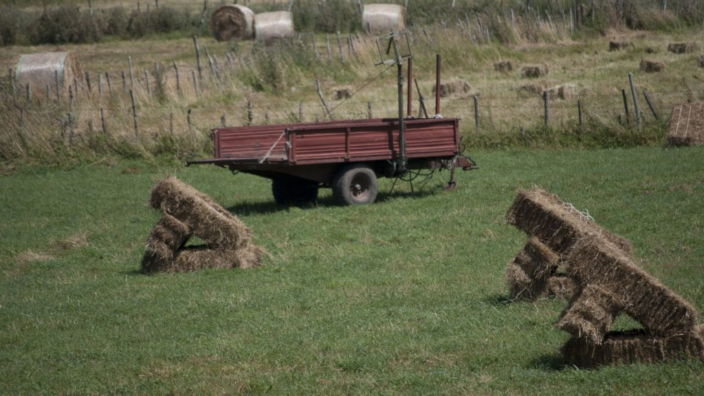 picture of square bales in a field, bales of hay,
