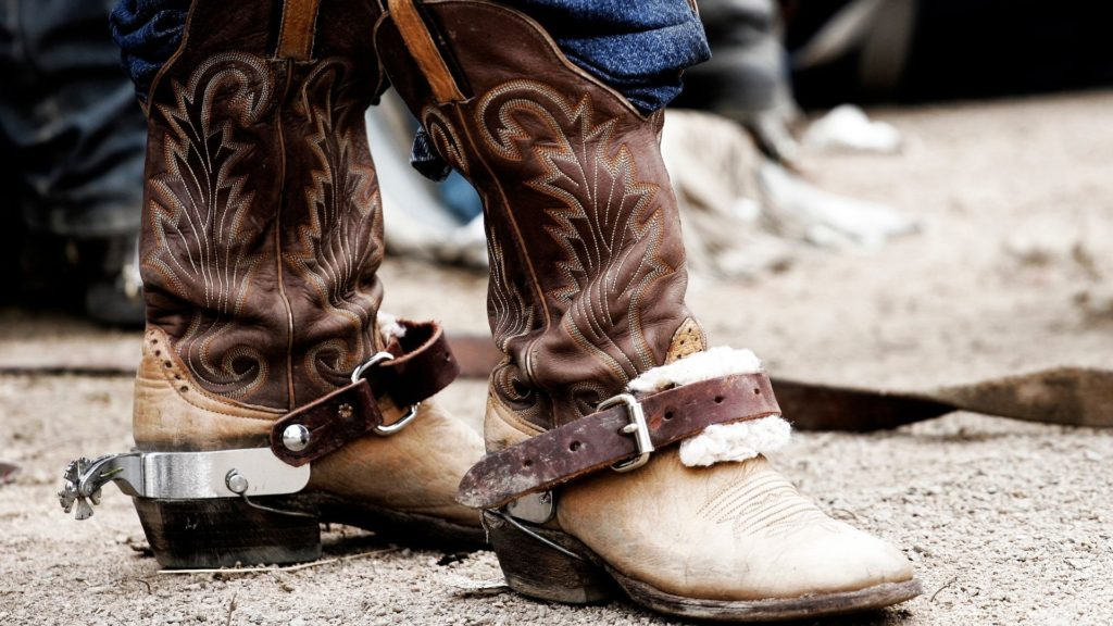 picture of a person wearing spurs on their cowboy boots,