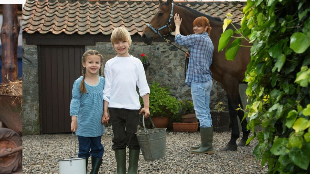 Picture of two girls holding feed buckets near their horse, with their mother in the background.