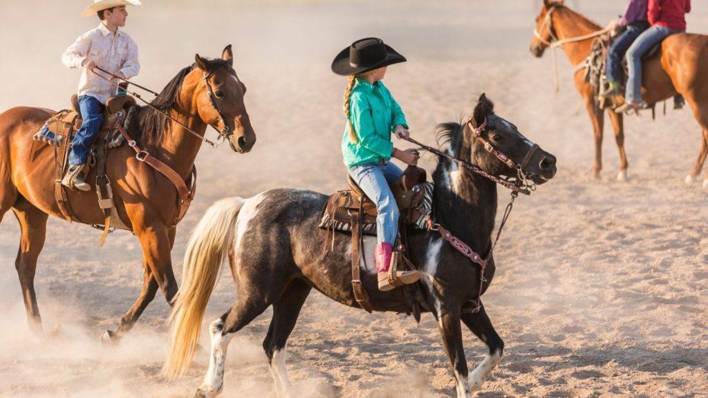 kids riding horses,