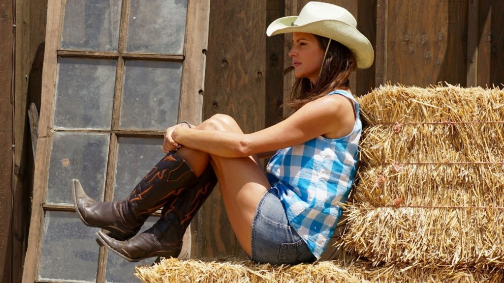 Picture of a woman wearing pointed-toe cowboy boots,