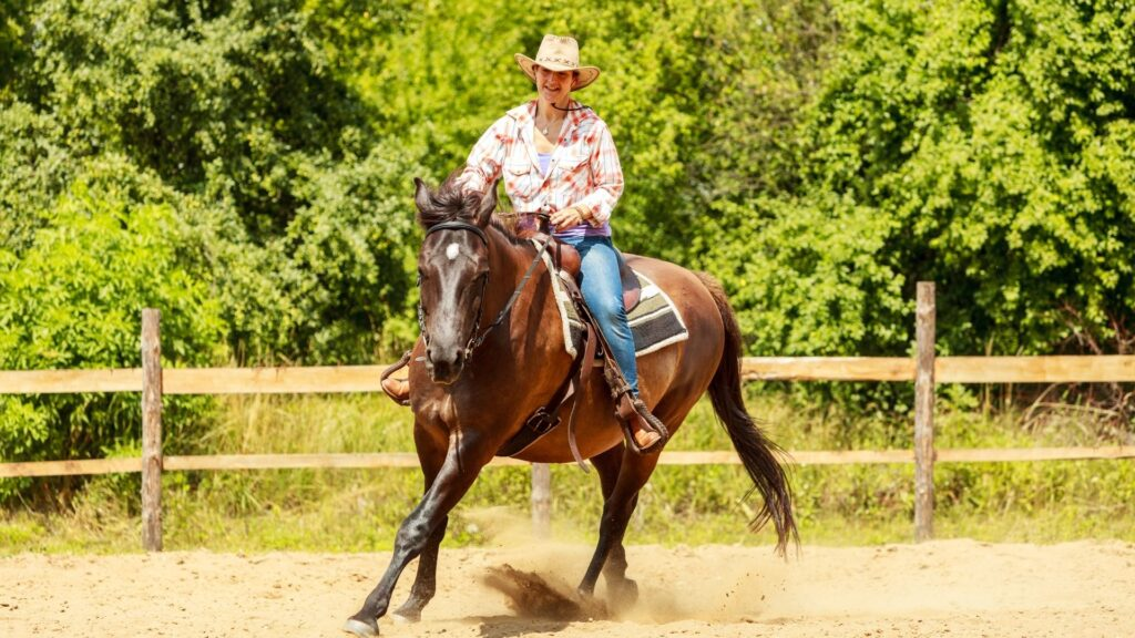 Picture of a woman horse riding western style