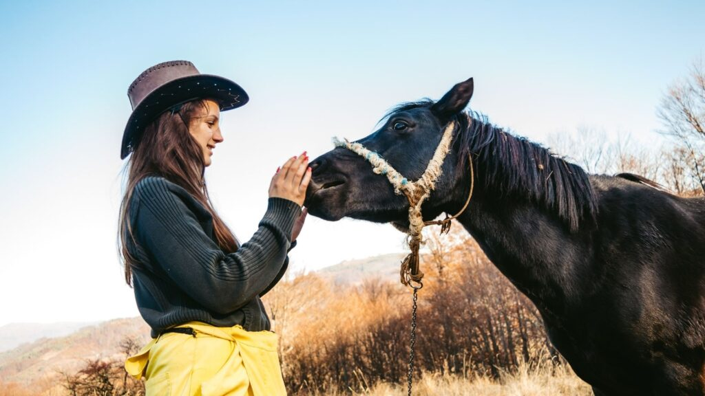 Picture of a woman and an old horse