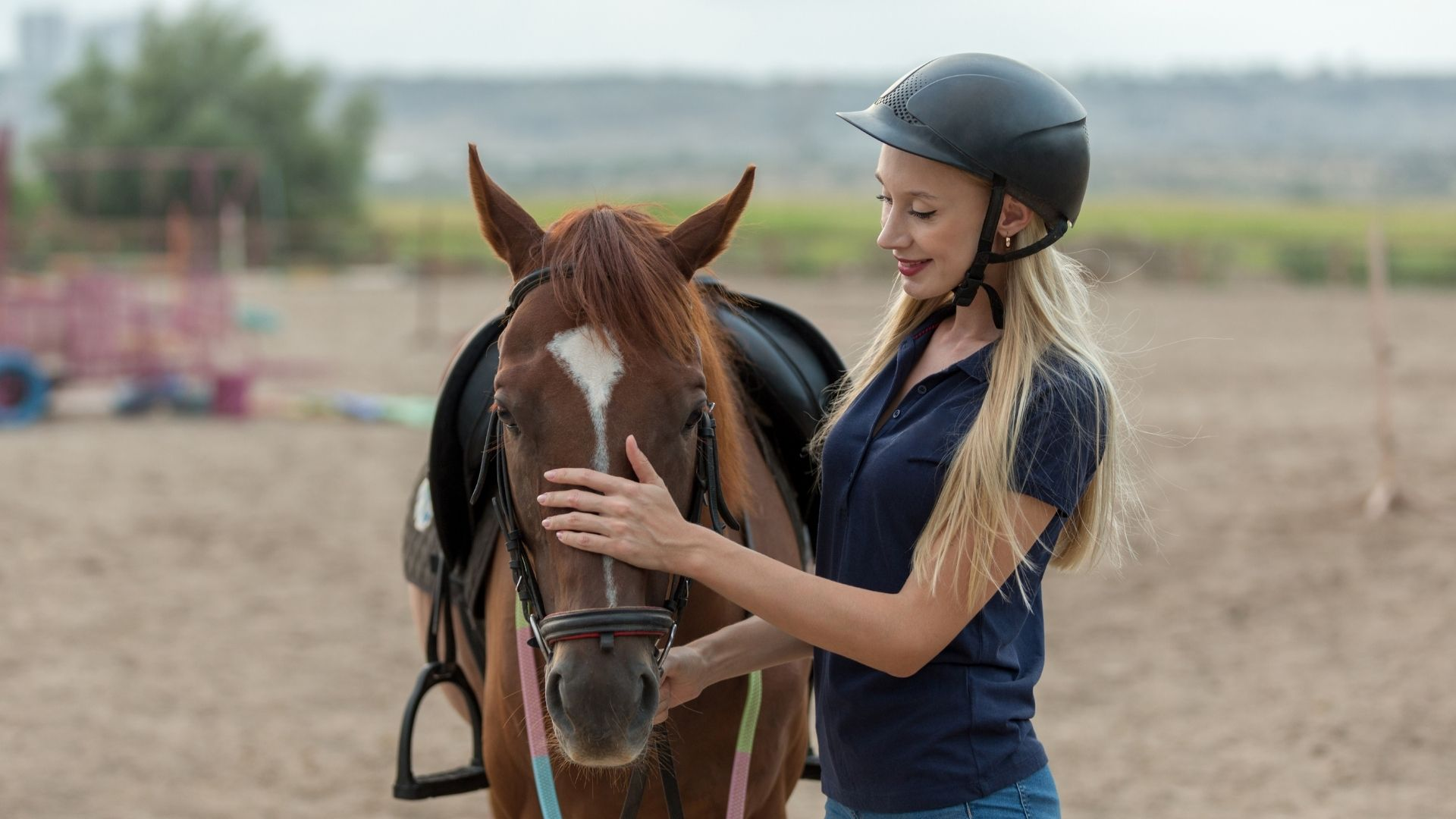 Picture of a beginner rider with a horse.