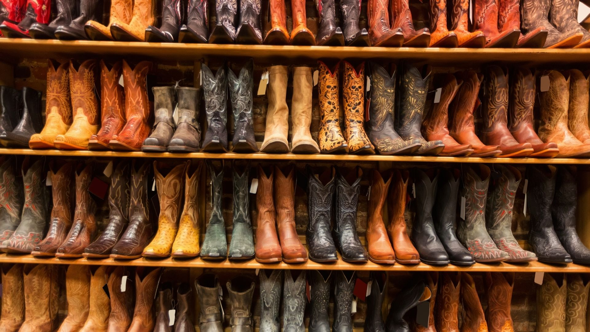 Picture of a bunch of pairs of cowboy boots.