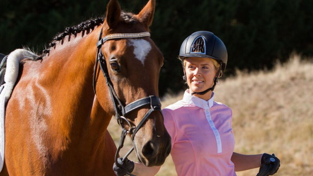 Picture of an equestrian and her horse.