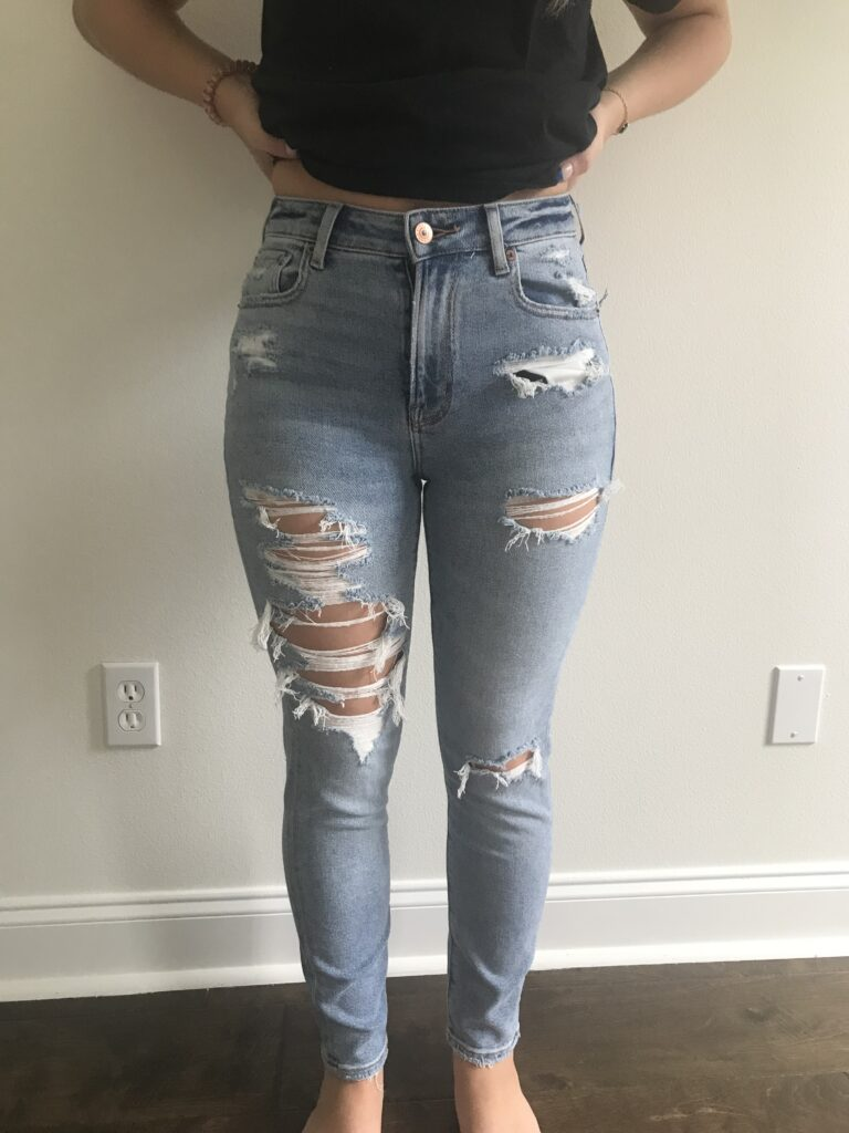 Picture of my daughter wearing mom jeans.