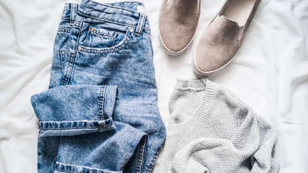 picture of a pair of mom jeans, a sweater, and shoes