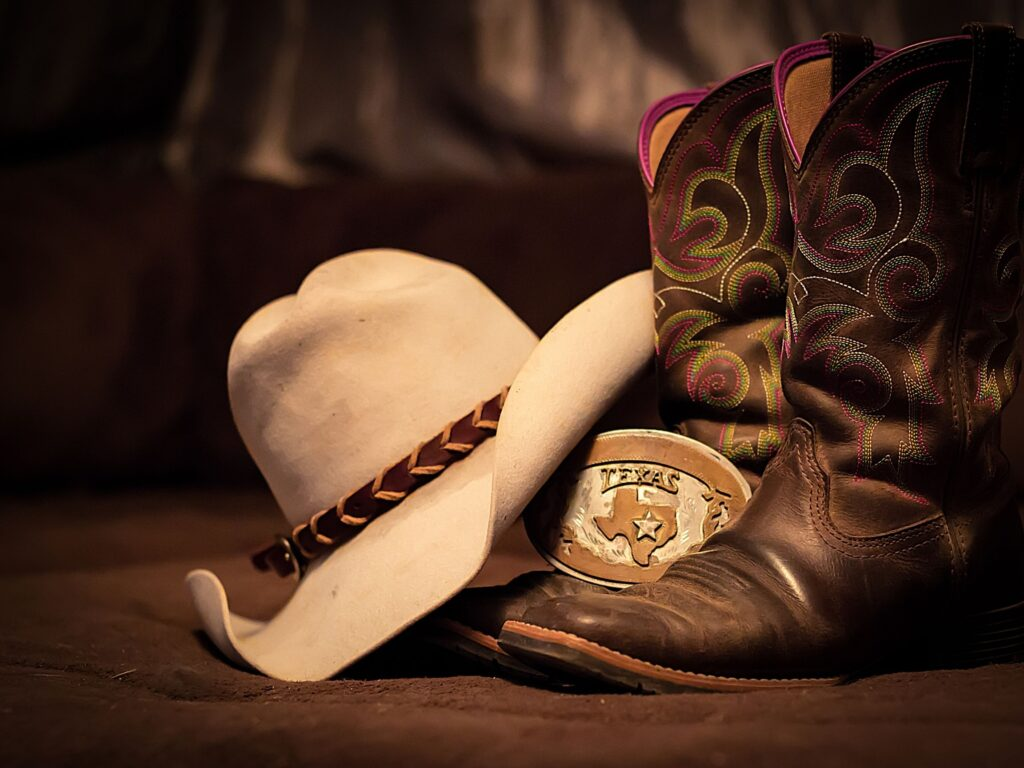 Picture of real cowboy boots with a cowboy hat